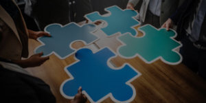 Accountability in the workplace is one of the pieces of the teamwork puzzle that ultimately improves performance —puzzle pieces ready to be put together.